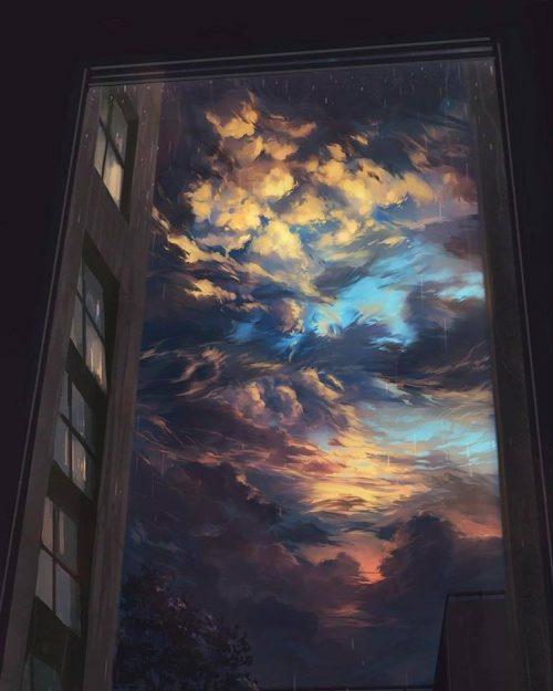 Una ventana abierta donde se ve un cielo parcialmente cubierto con distintos colores