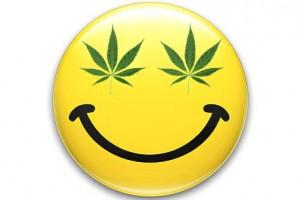Gráfico de una cara sonriente amarilla con hojas de marihuana en lugar de ojos